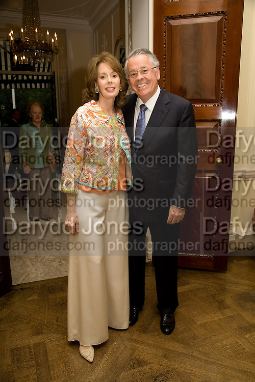 AMERICAN AMBASSADOR ROBERT TUTTLE  AND HIS WIFE   MARIA TUTTLE. Serpentine Pavilion opneing event: Drinks party hosted by the American Ambassador Robert Tuttle at his residence  in Regent's Park. .  *** Local Caption *** -DO NOT ARCHIVE-© Copyright Photograph by Dafydd Jones. 248 Clapham Rd. London SW9 0PZ. Tel 0207 820 0771. www.dafjones.com.