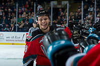 KELOWNA, CANADA - NOVEMBER 29: Carsen Twarynski #18 of the Kelowna Rockets makes his signature celebration face after scoring this third goal and the hat trick against the Prince George Cougars on November 29, 2017 at Prospera Place in Kelowna, British Columbia, Canada.  (Photo by Marissa Baecker/Shoot the Breeze)  *** Local Caption ***