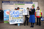 © Licensed to London News Pictures. 16/02/2013. Hammersmith, UK Retired Community Matron, Anne Dirinkell uses a megaphone outside the Town Hall. Activists hold a protest today, 16th February 2013, outside Hammersmith Town Hall at the end of a week of action against the forthcoming closure of NHS A&E departments at Hammersmith, Charing Cross, Ealing and Central Middlesex hospitals.  Photo credit : Stephen Simpson/LNP