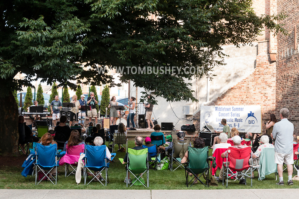 """Middletown, New York - The band """"Side by Side"""" performs on the stage during the Middletown Summer Concert Series in Run 4 Downtown Park on June 22, 2017."""