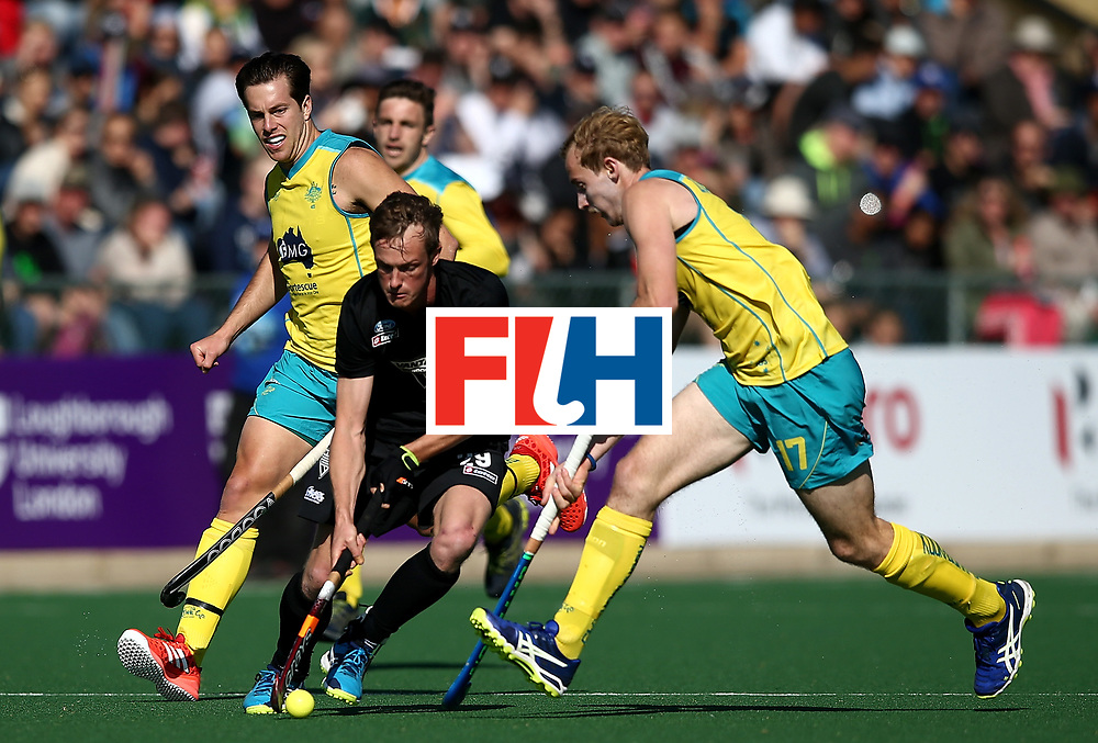 JOHANNESBURG, SOUTH AFRICA - JULY 15:  Hugo Inglis of New Zealand gets the controls the ball from Aran Zalewski of Australia during day 4 of the FIH Hockey World League Men's Semi Finals Pool A match between New Zealand and Australia at Wits University on July 15, 2017 in Johannesburg, South Africa.  (Photo by Jan Kruger/Getty Images for FIH)