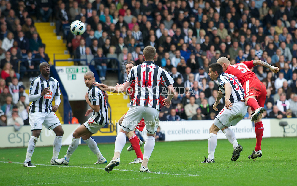 WEST BROMWICH, ENGLAND - Saturday, April 2, 2011: Liverpool's scores his side's opening goal against West Bromwich Albion during the Premiership match at The Hawthorns. (Photo by Dave Kendall/Propaganda)