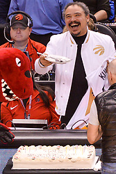 January 11, 2019 - Toronto, Ontario, Canada - Toronto Raptor mascot congratulate of a Canadian public address announcer for the Toronto Raptors of the National Basketball Association Herbie Kuhn with 50th anniversary during the Toronto Raptors vs Brooklyn Nets NBA regular season game at Scotiabank Arena on January 11, 2019, in Toronto, Canada (Toronto Raptors win 122-105) (Credit Image: © Anatoliy Cherkasov/NurPhoto via ZUMA Press)