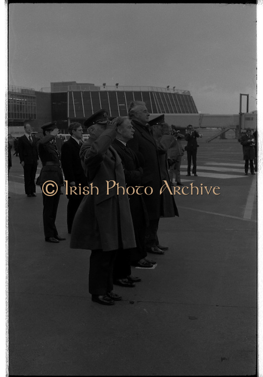 Australian Prime Minister Visits Ireland.   (H79)..1974..23.12.1974..12.23.1974..23rd December 1974..As part of his tour of E.E.C. Capital Cities,Mr Gough Whitlam, the Australian Prime Minister visited Dublin today. In Dublin he will have talks with An Taoiseach, Mr Liam Cosgrave...Image of An Taoiseach,Liam Crosgrave and the Australian prime minister, Mr Gough Whitlam,standing at attention for the playing of the National Anthems.