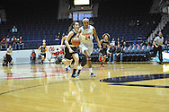 "Ole Miss' Bretta Hart (24) scores against Christian Brothers ' Madison Luckett (23) in an exhibition basketball game at the C.M. ""Tad"" Smith Coliseum in Oxford, Miss. on Friday, November 7, 2014. (AP Photo/Oxford Eagle, Bruce Newman)"