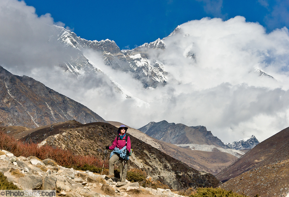 Lhotse (27,940 feet), the world's fourth highest peak, Nepal. The south face of Lhotse rises 3.2 km (1.98 mi) in only 2.25 km (1.4 mi) of horizontal distance (55 degree angle slope), making it the steepest face of this size in the world. Sagarmatha National Park was created in 1976 and honored as a UNESCO World Heritage Site in 1979.