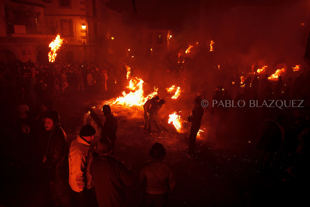 2016/12/07 Jarandilla de la Vera, Spain: Revellers take part during 'Los Escobazos' Festival on December 7, 2013 in Jarandilla de la Vera, in Extremadura region, Spain. Although the origin of 'Los Escobazos' is unknown, it is believed that goat shepherds used to walk down from Gredos mountains to the village to cerebrate the Immaculate Conception procession lighting their way with broom torches. The ritual takes place every December 7, one day before Immaculate Conception day, because the following morning shepherds had to be back with their herd in the mountains. Villagers also used to bring their donkeys to the procession on the belief that this would bless them keeping illnesses away from them. At nightfall people make bonfires in the streets and start a battle with burning brooms, followed by the Immaculate Conception Procession. (Photo by Pablo Blazquez Dominguez)