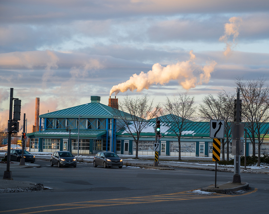 Quebec City, Quebec, Canada -- November 30, 2019.  Steam risies from the chimney of a commercial building on the bank of the St Lawrence River in Quebec City, Canada.