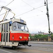 Tram in Prague with Prague Castle in the distance