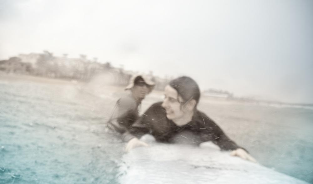 Girl on surfboard in rainy Florida