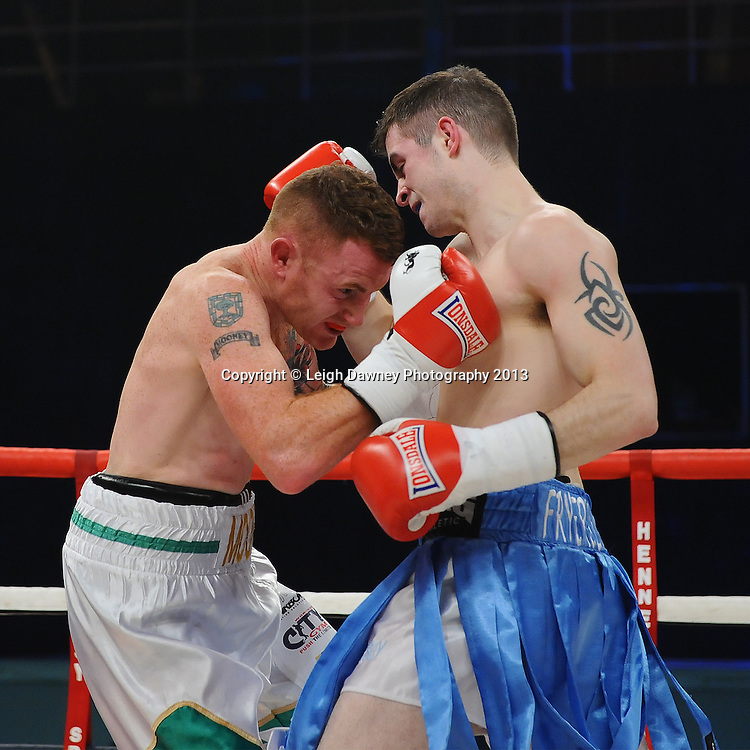 James Fryers (blue shorts) defeats Michael Mooney in a Lightweight contest on 15th March 2014 at the Rivermead Leisure Centre, Reading, Berkshire. Promoted by Hennessy Sports. © Leigh Dawney Photography 2014.