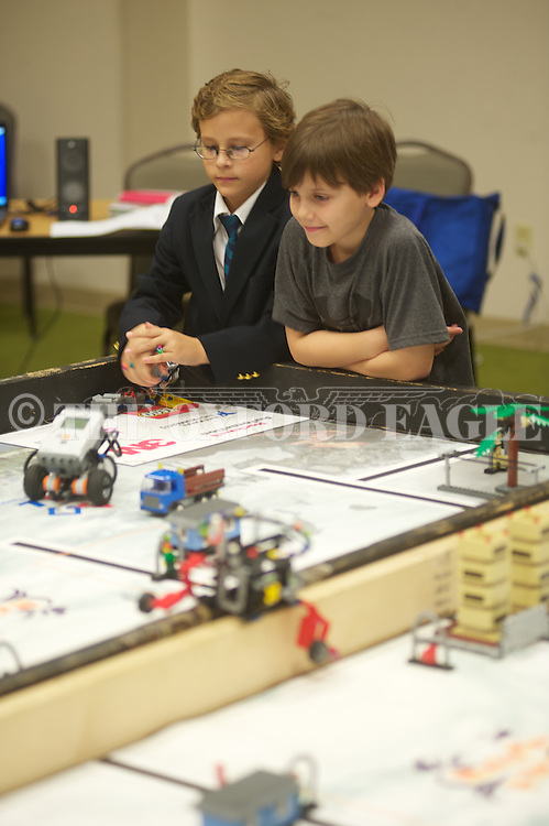 Della Davidson INSIGHTS students Webb Murphey left) and John Bial participate in the first Lego League Competition, at the Oxford Conference Center in Oxford, Miss. on Thursday, November 21, 2013. Students programmed a robot to mov around obstacles.