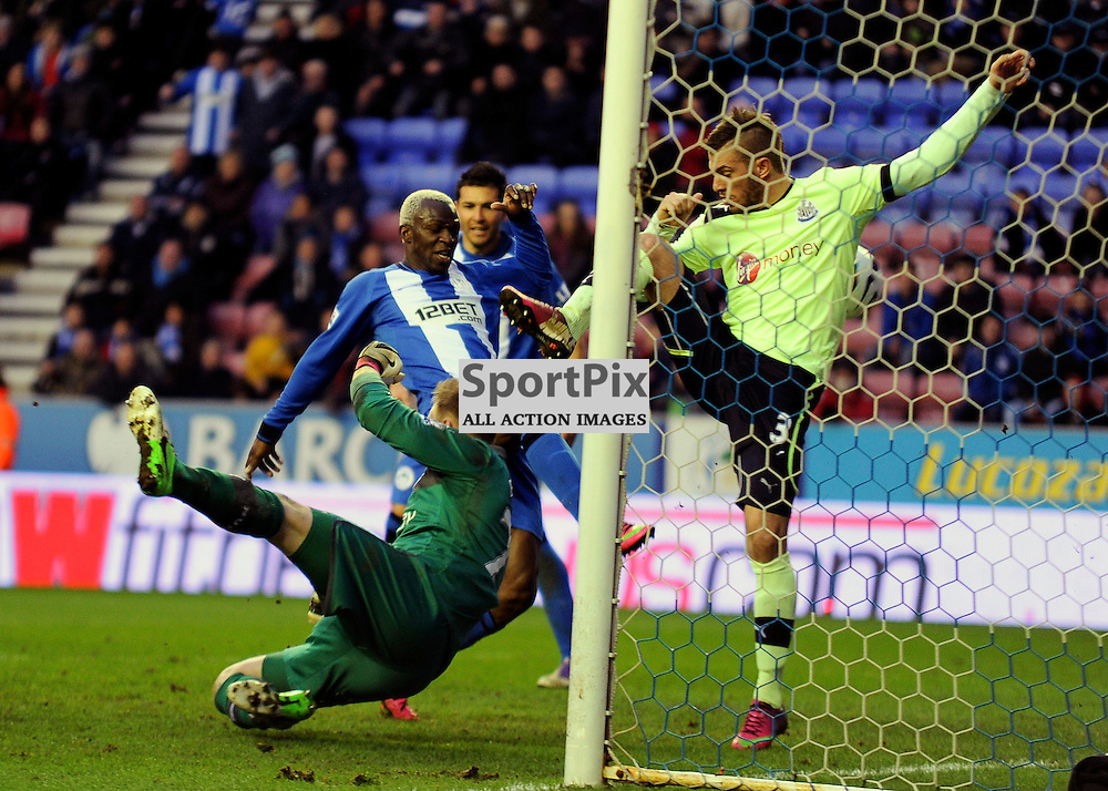 Arouna Kone scores the winner - Wigan Athletic v Newcastle United Barclays Premier League DW Stadium 17 March 2013 (c) Greig Bertram | StockPix.eu