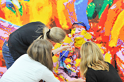 © Licensed to London News Pictures. 17/09/2017. London, UK.  Artists apply paint to help make Chinese artist Liu Bolin  become invisible as part of his first live UK performance, 'The Disappearing Act', at START Art Fair presented by Mehta Bell Projects in London's Saatchi Gallery.   Photo credit : Stephen Chung/LNP