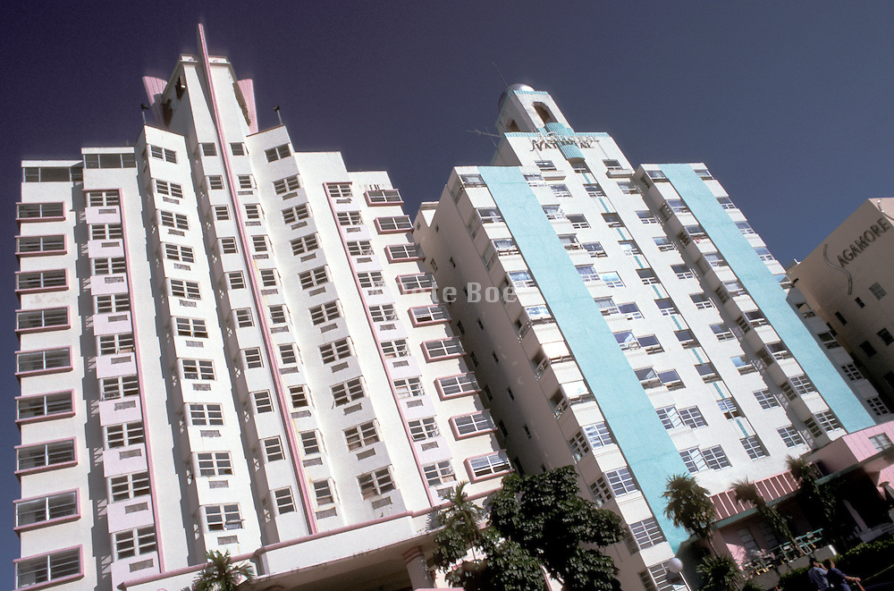 upward view of 2 hotels in tropical setting