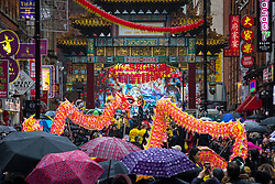 © Licensed to London News Pictures . 26/01/2020. Manchester, UK. A dragon dances in front of crowds on Faulkner Street in Manchester's China Town . Thousands of people watch a display of oriental culture and a procession through Manchester city centre to mark Chinese New Year . Photo credit: Joel Goodman/LNP