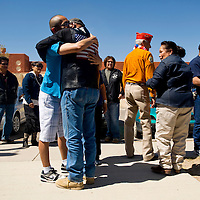 042213       Brian Leddy<br /> Jason Silversmith gets a hug from his grandfather Roland Gordon during a welcome home ceremony Monday afternoon. Silversmith recently returned home to Gallup after serving in the Army in Afghanistan.