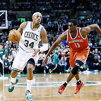 21 December 2012: Boston Celtics small forward Paul Pierce (34) drives past Milwaukee Bucks power forward Ekpe Udoh (13) on a screen set by Boston Celtics power forward Kevin Garnett (5) during the Milwaukee Bucks 99-94 overtime victory over the Boston Celtics at the TD Garden, Boston, Massachusetts, USA.