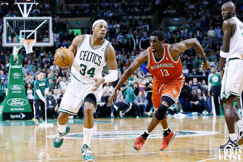21 December 2012: Boston Celtics small forward Paul Pierce (34) drives past Milwaukee Bucks power forward Ekpe Udoh (13) on a screen set by Boston Celtics power forward Kevin Garnett (5) during the Milwaukee Bucks 99-94 overtime victory over the Boston Celtics at the TD Garden, Boston, Massachusetts, USA.