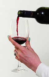 Undated file photo of a glass of red wine being poured. Brexit has already pushed the price of a bottle of wine to an all-time high, with further rises predicted, a trade body said.