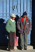 Two men chatting on the street, Uyuni, Potosi, Bolivia