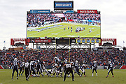 The scoreboard shows the play in progress as the Denver Broncos kick a fourth quarter field goal that cuts the Tennessee Titans lead to 13-10 during the 2016 NFL week 14 regular season football game against the Denver Broncos on Sunday, Dec. 11, 2016 in Nashville, Tenn. The Titans won the game 13-10. (©Paul Anthony Spinelli)
