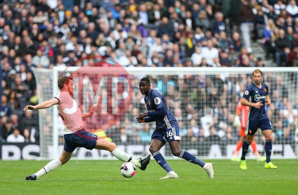 Abdoulaye Doucoure of Watford passes a ball past the outstrecthed leg of Jan Vertonghen of Tottenham Hotspur - Mandatory by-line: Arron Gent/JMP - 19/10/2019 - FOOTBALL - Tottenham Hotspur Stadium - London, England - Tottenham Hotspur v Watford - Premier League