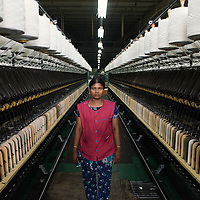 A portrait of a female textile worker