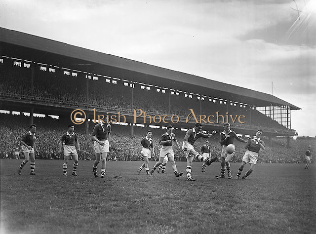 Cork player kicks the ball down field during the All Ireland Senior Gaelic Football Championship Final Louth v Cork at Croke Park on the 22nd September 1957. Louth 1-09 Cork 1-07.