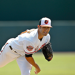 March 24, 2012; Sarasota, FL, USA; Baltimore Orioles starting pitcher Jake Arrieta (34) throws against the Washington Nationals during the top of the first inning of a spring training game at Ed Smith Stadium.  Mandatory Credit: Derick E. Hingle-US PRESSWIRE