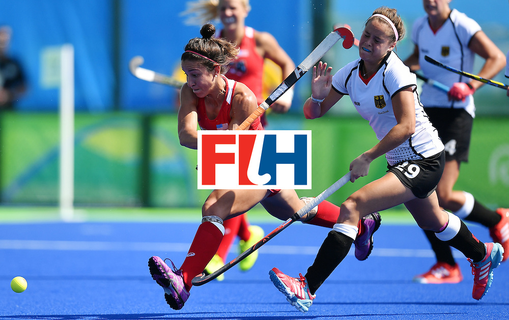 The USA's Melissa Gonzalez (L) hits with her stick Germany's Pia-Sophie Oldhafer during the women's quarterfinal field hockey USA vs Germany match of the Rio 2016 Olympics Games at the Olympic Hockey Centre in Rio de Janeiro on August 15, 2016. / AFP / MANAN VATSYAYANA        (Photo credit should read MANAN VATSYAYANA/AFP/Getty Images)