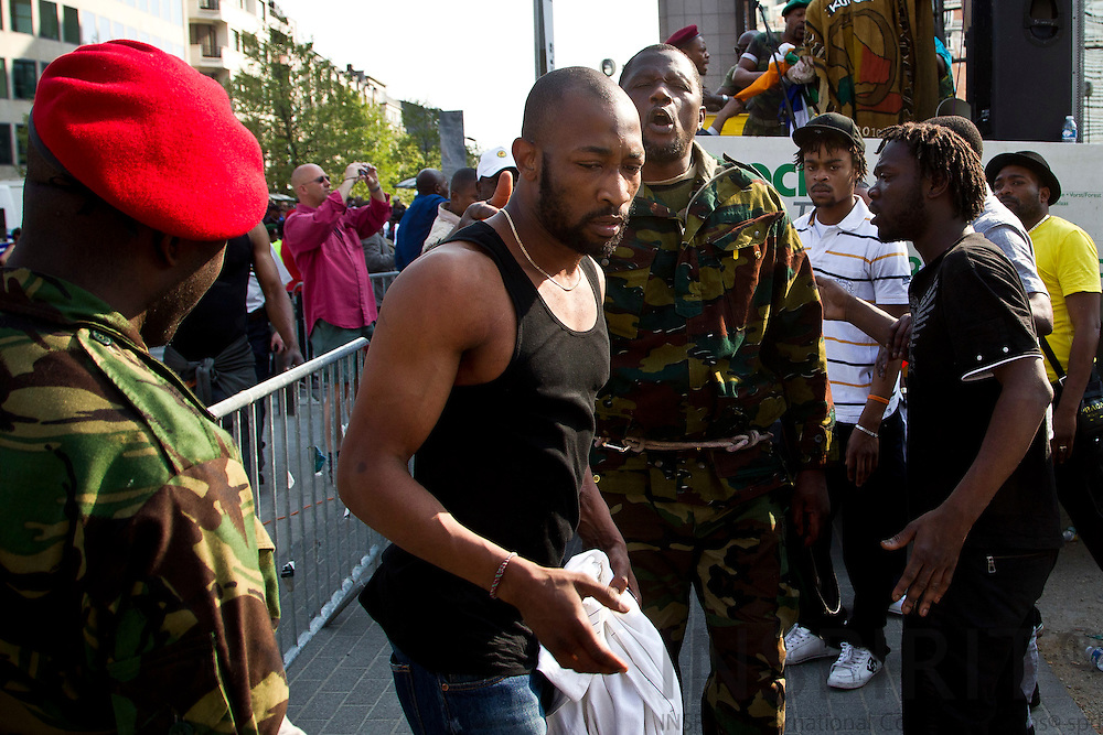 Congolese residents of Brussels protested against Congolese President Joseph Kabila, in Brussels, Saturday 23 April 2011. After a march to the EU institutions they stopped to make speeches. This man i white ended up getting in troubles with the other congolese leaders.  Photo: Erik Luntang / INSPIRIT Photo