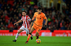 STOKE-ON-TRENT, ENGLAND - Wednesday, November 29, 2017: Liverpool's Dominic Solanke and Stoke City's Joe Allen during the FA Premier League match between Stoke City and Liverpool at the Bet365 Stadium. (Pic by David Rawcliffe/Propaganda)