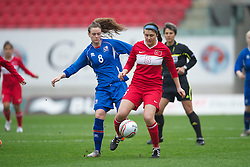 LLANELLI, WALES - Thursday, March 31, 2011: Iceland's Katrin Asbjornsdottir and Turkey's Melisa Dilber Ertu?rk during the UEFA European Women's Under-19 Championship Second Qualifying Round (Group 3) match at Parc Y Scarlets. (Photo by David Rawcliffe/Propaganda)