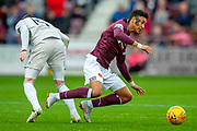 Sean Clare (#9) of Heart of Midlothian is fouled by Scott Wright (#15) of Aberdeen FCduring the Ladbrokes Scottish Premiership match between Heart of Midlothian and Aberdeen at Tynecastle Stadium, Edinburgh, Scotland on 20 October 2018.