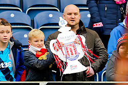 A young Stoke City fan holds up a home made FA Cup -  Photo mandatory by-line: Matt McNulty/JMP - Mobile: 07966 386802 - 14/02/2015 - SPORT - Football - Blackburn - Ewood Park - Blackburn Rovers v Stoke City - FA Cup - Fifth Round