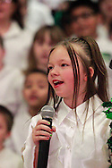 Isabella Roseberry leads the Singing Chargers as they perform Mistletoe during the 'We Will Jingle!' arts concert at Cleveland PK-8 school in Dayton, Wednesday, December 12, 2012.