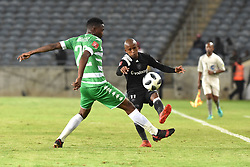 Luvuyo Memela of Orlando Pirates battle for the ball with Tshepo Rikhotso of Bloemfontein Celtic during the ABSA premiership league at Orlando stadium, Soweto.<br />