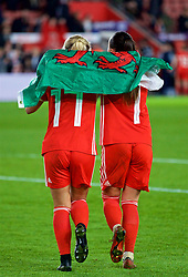 SOUTHAMPTON, ENGLAND - Friday, April 6, 2018: Wales' Charlie Estcourt and Natasha Harding celebrate at the final whistle after a hard fought goal-less draw against England during the FIFA Women's World Cup 2019 Qualifying Round Group 1 match between England and Wales at St. Mary's Stadium. (Pic by David Rawcliffe/Propaganda)