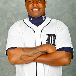 February 28, 2012; Lakeland, FL, USA; Detroit Tigers left fielder Delmon Young (21) poses for photo day in the rec room at the Detroit Tigers Headquarters.  Mandatory Credit: Derick E. Hingle-US PRESSWIRE