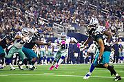 ARLINGTON, TX - OCTOBER 14:  Ezekiel Elliott #21 of the Dallas Cowboys runs the ball during a game against the Jacksonville Jaguars at AT&T Stadium on October 14, 2018 in Arlington, Texas.  The Cowboys defeated the Jaguars 40-7.  (Photo by Wesley Hitt/Getty Images) *** Local Caption *** Ezekiel Elliott