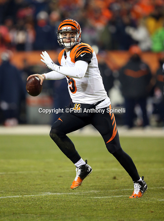 Cincinnati Bengals quarterback AJ McCarron (5) throws a pass for a gain of 12 yards and a first down at the Denver Broncos 10 yard line in the second quarter during the 2015 NFL week 16 regular season football game against the Denver Broncos on Monday, Dec. 28, 2015 in Denver. The Broncos won the game in overtime 20-17. (©Paul Anthony Spinelli)