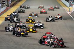 Motorsports / Formula 1: World Championship 2010, GP of Singapore, 02 Lewis Hamilton (GBR, Vodafone McLaren Mercedes), 01 Jenson Button (GBR, Vodafone McLaren Mercedes),  start, mass, Masse, Menge