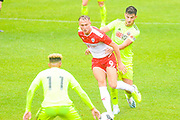Barnsley Cauley Woodrow (9) passes the ball during the Pre-Season Friendly match between Barnsley and Sheffield United at Oakwell, Barnsley, England on 27 July 2019.