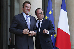 April 28, 2017 - Paris, France - French president FRANCOIS HOLLANDE (R) welcomes US actor and former governor of California ARNOLD SCHWARZENEGGER (R) prior to a meeting at the Elysee palace. (Credit Image: © Geoffroy Van Der Hasselt/NurPhoto via ZUMA Press)