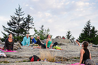 Kate Criscone from Body Design by Joy leads her group in a sunrise yoga class from the top of Piper Mountain on Saturday morning.  (Karen Bobotas/for the Laconia Daily Sun)