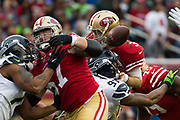 San Francisco 49ers quarterback C.J. Beathard (3) loses the ball as he gets hit by the Seattle Seahawks defense at Levi's Stadium in Santa Clara, Calif., on November 26, 2017. (Stan Olszewski/Special to S.F. Examiner)