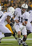 October 20 2012: Penn State Nittany Lions quarterback Matthew McGloin (11) hands the ball off to Penn State Nittany Lions running back Bill Belton (1) during the first half of the NCAA football game between the Penn State Nittany Lions and the Iowa Hawkeyes at Kinnick Stadium in Iowa City, Iowa on Saturday October 20, 2012. Penn State defeated Iowa 38-14.