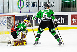 17.02.2015, Hala Tivoli, Ljubljana, SLO, EBEL, HDD Telemach Olimpija Ljubljana vs EC KAC, 4. Qualification Round, in picture Miika Wiikman (HDD Telemach Olimpija, #35) and Bostjan Groznik (HDD Telemach Olimpija, #6) during the Erste Bank Icehockey League 4. Qualification Round between HDD Telemach Olimpija Ljubljana and EC KAC at the Hala Tivoli, Ljubljana, Slovenia on 2015/02/17. Photo by Morgan Kristan / Sportida