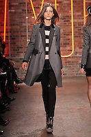 Tati Cotliar walks the runway wearing DKNY Fall 2011 Collection during Mercedes-Benz Fashion Week in New York on February 13, 2011
